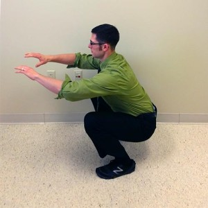 Squat demonstration at Capital Chiropractic