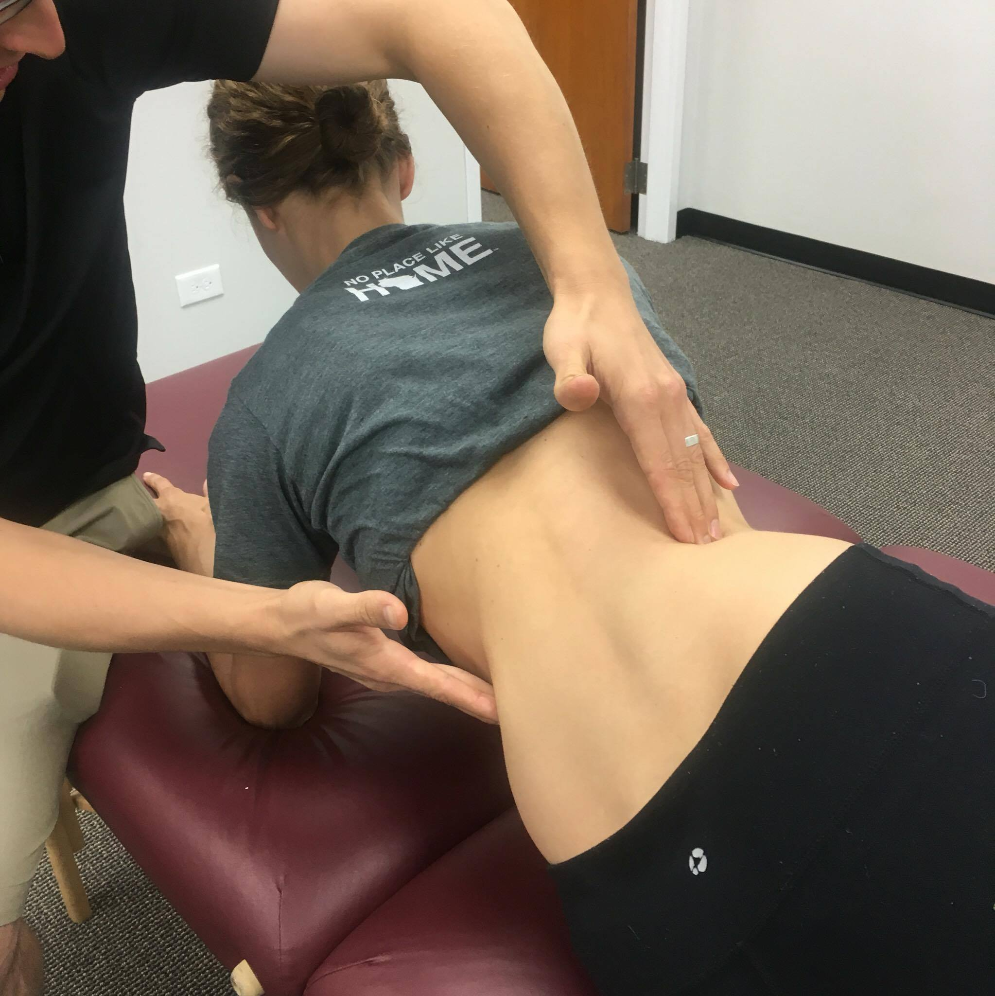 Marcela Safarova working with Dr. Boland to engage appropriate thoracic spine motion while maintaining intra-abdominal pressure.