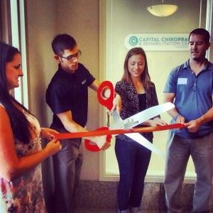 Dr. Chris LoRang at Capital Chiropractic & Rehabilitation Center's ribbon cutting in Des Moines' East Village.