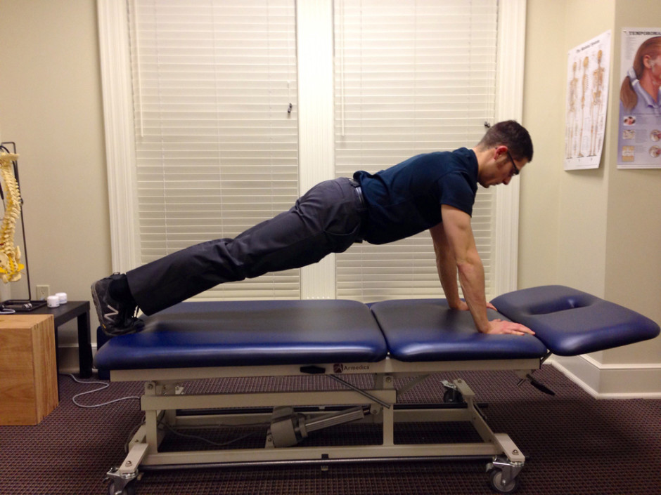 Front plank Capital Chiropractic and Rehabilitation Center
