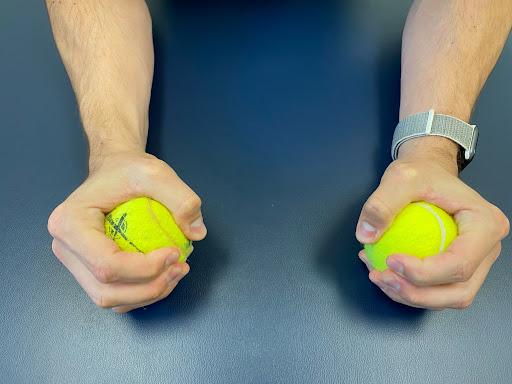 squeezing tennis balls